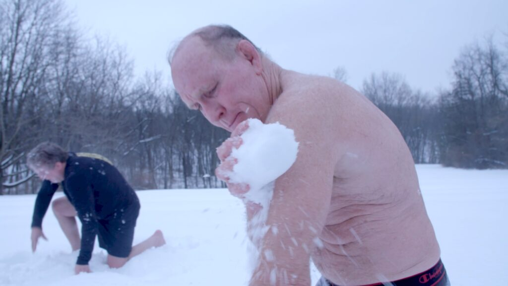 Dan Gable cooling off in the snow after a sauna session